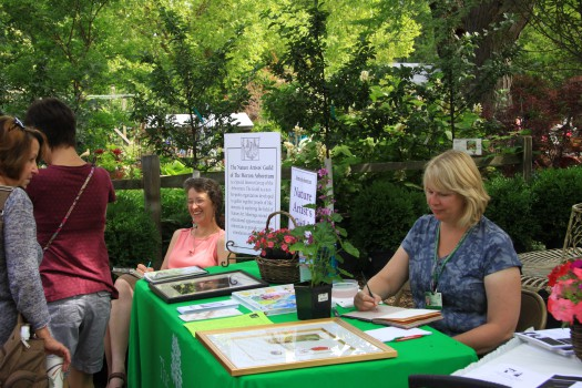 Suzanne Wegener and Karen Johnson at the Nature Artists' Guild Information Table at The Growing Place