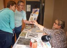 Carol Cooley applying watercolor to block print